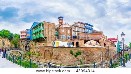 TBILISI GEORGIA - MAY 28 2016: The colorful houses with carved wooden balconies located on the of the Fig Gorge in Abanotubani neighborhood on May 28 in Tbilisi.