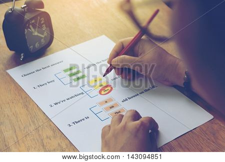 doing english test on table with clock
