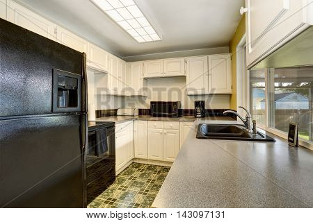Classic American Kitchen Romm Interior With White Wooden Cabinets.