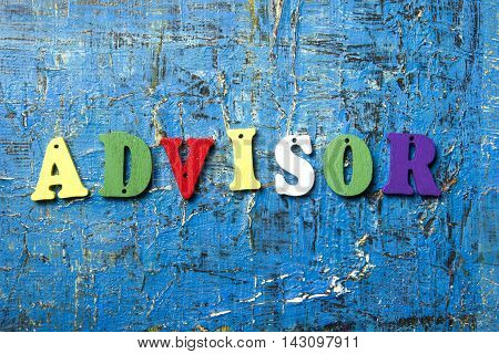 the word of ADVISOR on colorful abc letters at abstract blue background.