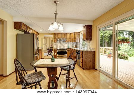 Kitchen Room Interior With Stainless Steel And Hardwood Floor.