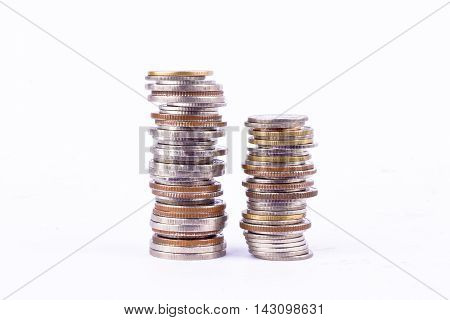 a pile of  coins stacks money on white background finance business isolated