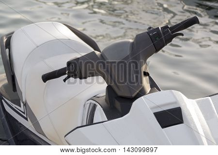 jet ski white and black colored parked on the pier
