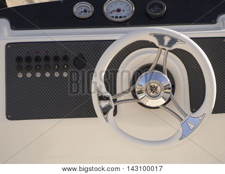 Steering wheel and dashboard of a yacht