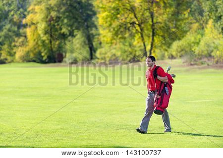 Golfer on a golf course, toned imge, horizontal