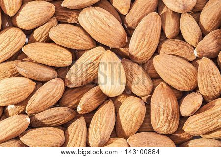Background of whole almonds group close up