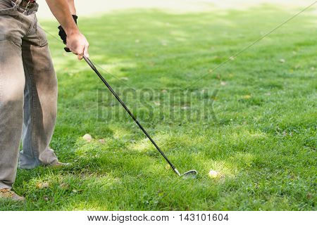 Golf Club And Golf Ball On Playing Field