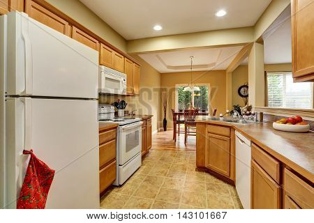 Kitchen Room Interior With Tile Floor Connected To Dining Area
