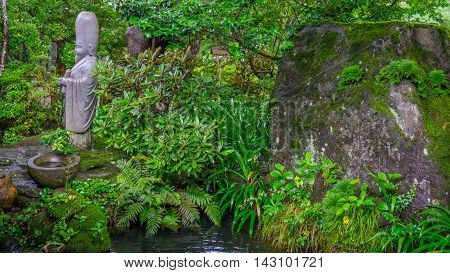 Small statue found in the quietness of a Japanese garden