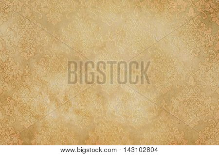 Old yellowed paper background with decorative vintage patterns Vintage paper texture for the design.