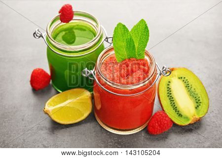Tasty smoothie drinks with fruits on table