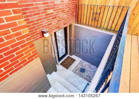 Exterior Steps Lead To Underground Basement Of The Brick House