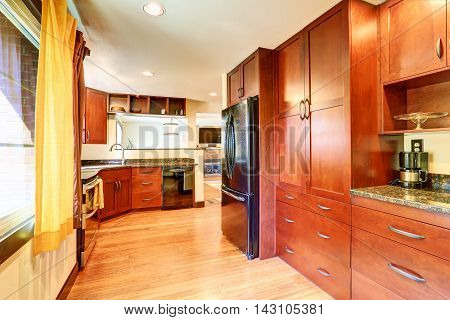 Kitchen Interior With Black Appliances And Granite Tops