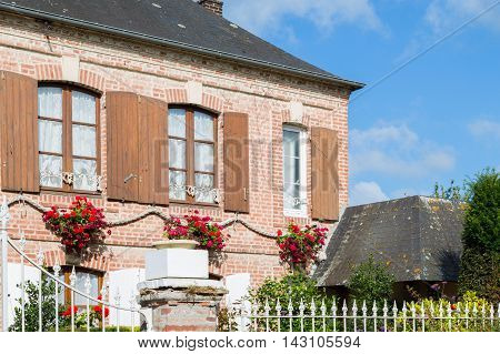 Traditional decorative flowers on around house in Normandy France