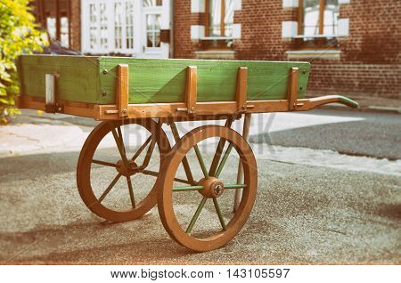 Wooden wagon next to some houses in Normandy France