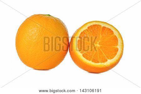 whole and cut ripe orange on a white background