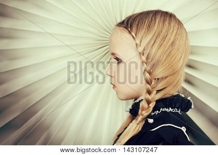 Girl with braids of blond hair fine art portrait