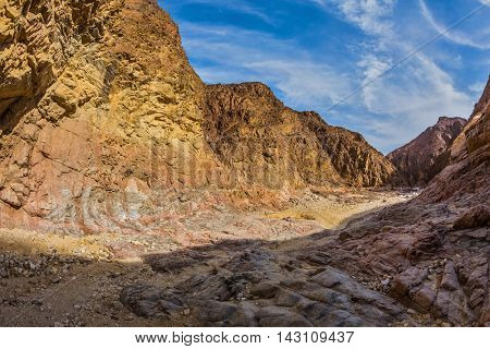 Israel in January. Picturesque and multi-color Black canyon in ancient Eilat mountains