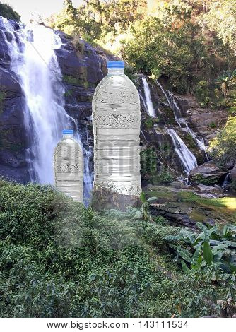 Bottles of fresh mineral water with waterfalls in background