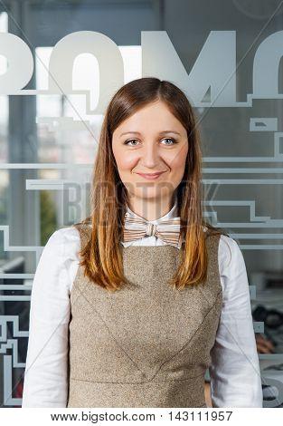 Portrait of a beutiful smiling business woman. Vertical shot.
