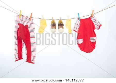 Baby clothes hanging on the rack isolated on white background.