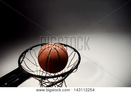 Basketball board and basketball ball on gray background