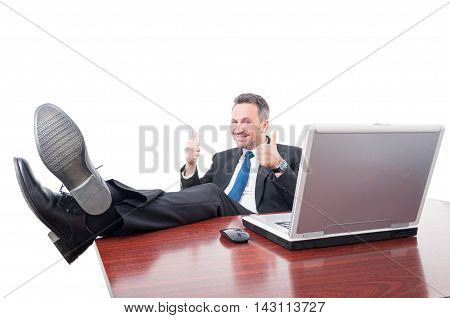 Cheerful Manager With Feet On Desk