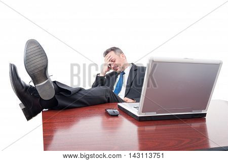 Businessman Taking A Nap With His Feet Up