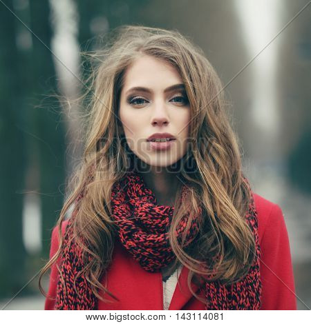 Portrait of a beautiful girl on cold windy day