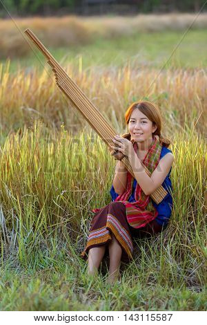 Beautiful Woman reed organ played by people of northeastern Thailand Thai instruments