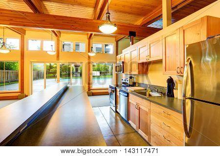 Open Floor Plan Kitchen Room. Exit To Backyard Swimming Pool.