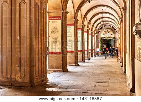 Montserrat Spain - April 6 2016: Arcades inside The Benedictine abbey of Santa Maria de Montserrat. Montserrat is a mountain top monastery in Catalonia situated atop an unusual rock mountain it is very popular among Catalans and Catholic pilgrims