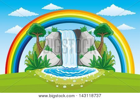 Beautiful waterfall and rainbow with clouds in the blue sky.