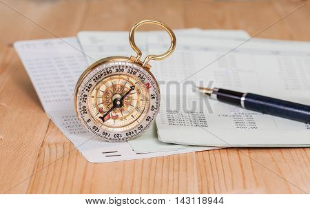 Saving account from bank with vintage compass