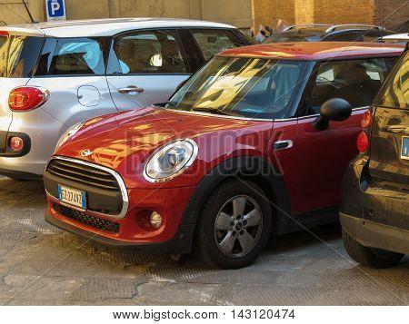 Red Mini Cooper Car In Siena