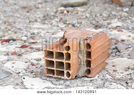 In the construction sector old and broken material; briquette.