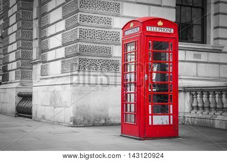Traditional old style British red telephone box in London, UK - black & white version