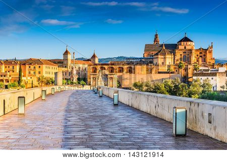 Cordoba Spain Andalusia. Roman Bridge on Guadalquivir river and The Great Mosque (Mezquita Cathedral)