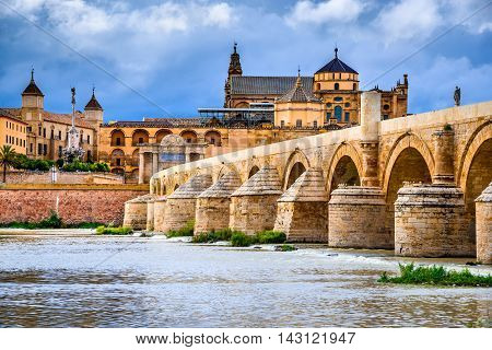 Cordoba Spain Andalusia. Roman Bridge on Guadalquivir river and The Great Mosque (Mezquita Cathedral).
