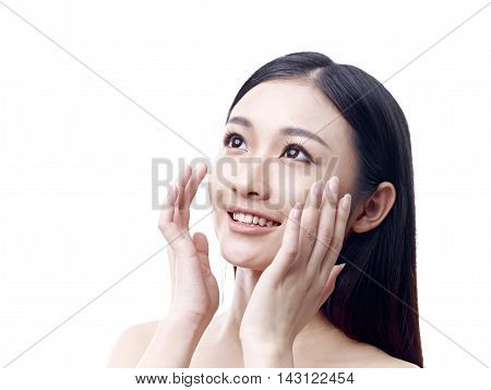 young asian woman rubbing face with hands happy and smiling isolated on white background.