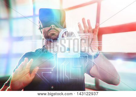 Circuit board and lock graphic against male business executive using virtual reality headset