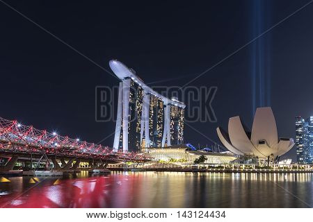SINGAPORE CITY SINGAPORE - AUGUST 9 2016: Marina Bay Sands and Art Science Museum at night with Light and Water Show