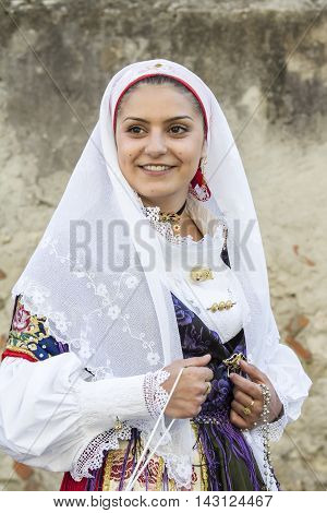 CAGLIARI, ITALY - May 1, 2015:  Religious Procession of Sant'Efisio - Sardinia - portrait of a beautiful smiling girl in traditional Sardinian costume
