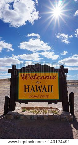 Welcome to Hawaii road sign with blue sky