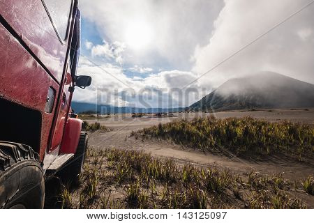 Red off road car at Bromo mountain, adventure trial
