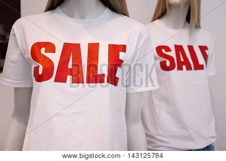 shop window mannequins or dummies advertising summer clearance sale