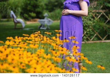 Pregnant Woman Holding Her Hands On Her Baby Bump.