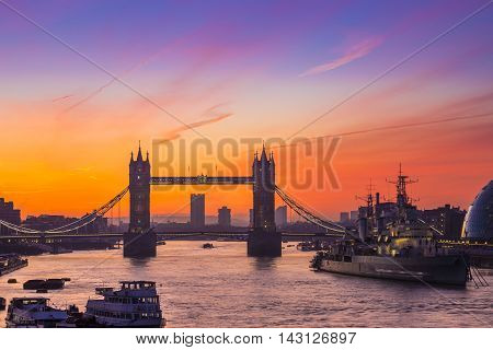 London, England - Tower Bridge and HMS Belfast cruiser at sunrise
