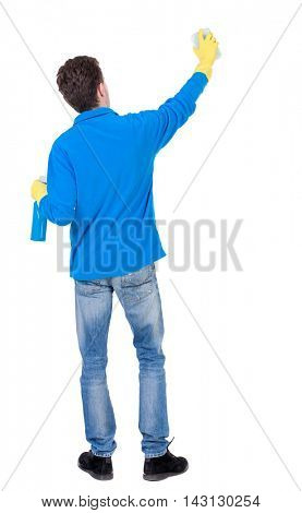 Back view of a cleaner man in gloves with sponge and detergent. girl  watching. Rear view people collection.  backside view of person.  Isolated over white background. Curly boy in a warm blue sweater
