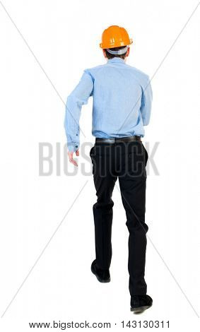 Back view of running engineer in helmet. Walking guy in motion. Rear view people collection. Backside view of person. Isolated over white background. Businessman in a blue shirt and a helmet in an